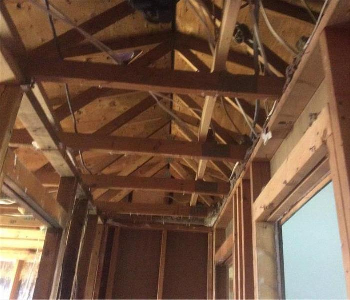 Room with new studs and roofing exposed beams