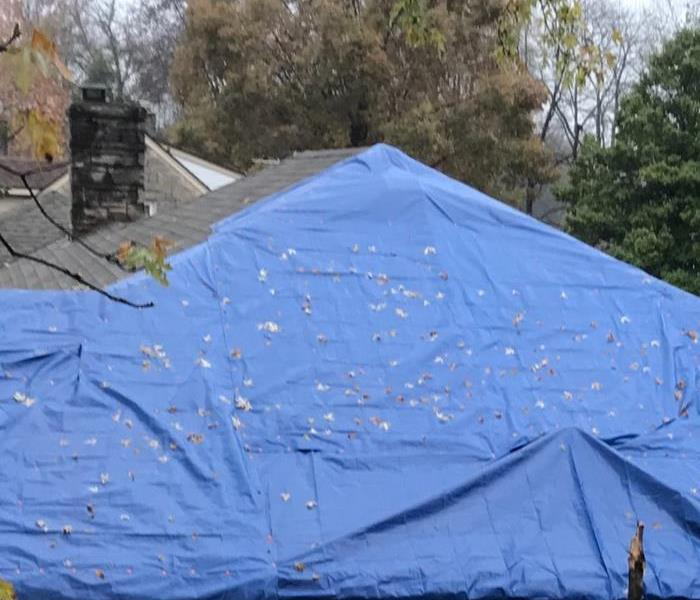 Roof tarped with a blue tarp